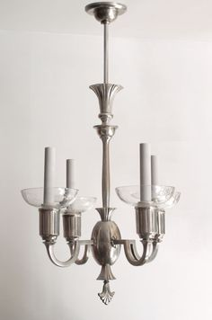 Delicate Swedish Art Deco pewter and crystal 4-arm chandelier | From a unique collection of antique and modern chandeliers and pendants  at https://www.1stdibs.com/furniture/lighting/chandeliers-pendant-lights/