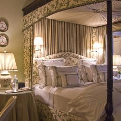 Summer style!! Classic and elegant four-poster bed with gorgeous bedding and fabrics! John Bossard