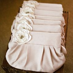 gathered clutch purse - champagne (by brighter day via emmaline bride) . also cute as bridesmaids gifts filled with stuff they could use on the wedding day plus afterwards :)