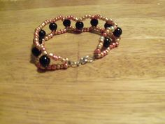 "8"" beaded, woven bracelet with metallic beads and black glass pearls by StrungOnLove on Etsy"
