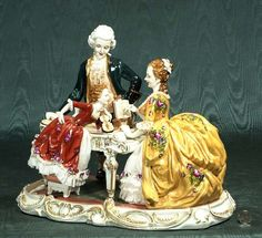 20: Porcelain music room group with a gentleman standin : Lot 20
