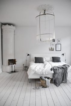 White and grey bedroom colours. Quite minimalistic, love what appears to possibly be the light fixture #grey #white #bedroom