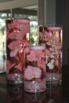 Wedding centerpieces pink-tinted water with jewels and orchids with a floating candle! - Click image to find more weddings posts