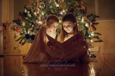 Create a similar shot with a light source to illuminate the book -- just a string of small, white indoor twinkle lights Xmas Photos, Family Christmas Pictures, Holiday Pictures, Christmas Photo Cards, Family Photos, Xmas Family Photo Ideas, Christmas Pictures With Lights, Xmas Pics, Family Posing