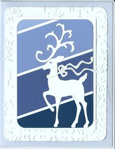 handmade winter card from I See A Pattern Forming ... blue paint chips placed on the diagonal .. die cut stag ... creative look ...