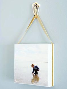 Love!-hanging beach photos with ribbon and a shell as a hook