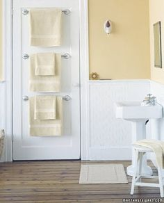 love the floor, wall color, towel bars on the door (and comments!)