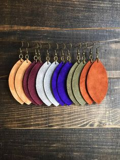 "These suede feather earrings are made of soft, lightweight suede. They come in 6 different colors: Carmel, cranberry, gray, prince purple, olive, and rust brown. They measure approximately 2.75"" long. They are a great piece to spice up any outfit! Leather earrings, suede earrings,"