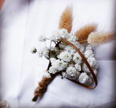 Rustic baby's breath boutineer for the LOVE BIRDS wedding. Boutineer created by Imprint Affair.