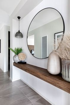Entrance with large round mirror - With a floating wooden shelf, perfect .- Entrance with large round mirror – With a floating wooden shelf, perfect for narrow corridors! Narrow Entryway, Entryway Mirror, Narrow Hallways, Entryway Ideas, Table Mirror, Narrow Hallway Decorating, Modern Entryway, Hallway Entrance Ideas, Small Entrance