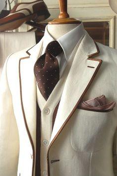 Sharp Dressed Man! Cream suit with coffee brown trim...