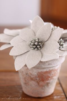 Felt flower, vintage jewelry and flower pot.