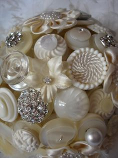 "button bouquet.  If I ever got married, and I'm not saying I would, but...  this would be a great way to incorporate ""something old"" - using buttons from my Nana's button basket, especially the lovely mother-of-pearl ones."
