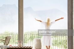 Woman in bathrobe overlooking landscape