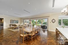 Wooden floors, open plan living and dining. Real estate photography by CT Creative.