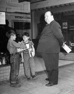 Alfred Hitchcock and two small boy extras, on location in Santa Rosa, California during the making of the film Shadow Of A Doubt (1943)