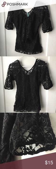 Black Lace Ruffle Top Like new condition! Tag does not list the size but it is most likely an extra-small. It has a loose ruffle layer on the front and a solid piece of black fabric that covers the front half of the shirt. The entire back and sleeves are completely sheer black lace. Destiny Tops Blouses