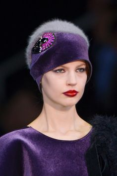 Emporio Armani Fall 2013 - I like the shape and the cocarde trim, but am not fond of the fuzzy mohair looking crown. #millinery #judithm