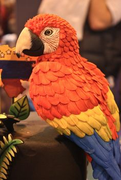 This is actually a cake, the feathers are fondant. Simply incredible work by Dahlia Cabrita de Pena of Venezuela.