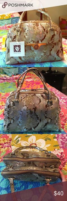 BRAND NEW Anne Klein Snake Print handbag NWT Beautiful snakeprint hand bag. Shimmery gold metallic. 2 larger compartments, front flap, 2 cellphone slip pockets and rear inside zipper. Comes with removable shoulder/crossbody strap. Per my measurements 11.5x8x5 with 4.5-5 inch drop. Anne Klein Bags Satchels