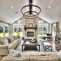 Living Room Dreams | Living Room Goals | Accent Chandelier | A Frame Ceiling | Stone Fire Place | Mantle | Oversized Coffee Table | Oversized Couch | Windows | Neutral Colors | Farmhouse Decor | Shabby Chic