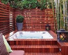 In  ground hot tub with brick and privacy screen. http://spasandstuff.com