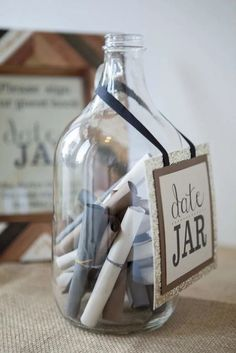 wedding guests place date night ideas in glass jar