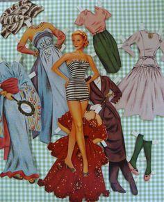 Vintage Cut out Paper Dolls  via Etsy.