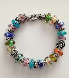 Bracelet of OOAKS. I like these Trollbeads. Wish they were mine! cs