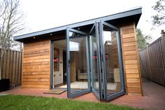 Garden Shed with large glass doors that open.....very nice! All the light my @Bonnie Plants will require! :-)