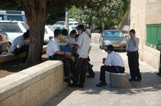 https://flic.kr/p/2Yd3Kq | Old City Jewish Quarter - Jerusalem Israel | Young yeshiva students sitting outside under the shade of a tree in the hot summer morning sun in the Jewish Quarter of Jerusalem's old city - Jerusalem - 29 August 2007