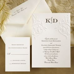 This simply elegant invitation card features an embossed filigree design surrounding your initials at the top.