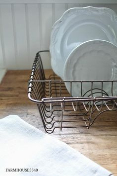 Repurpose those dish drainers. Purpoisely perfect for displaying china, albums, books.