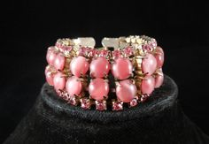 Today's favourite, 1950's Pink Moonstone & Rhinestone Bracelet, £28 by @allthatvintage  Beautiful Vintage 1950's Pink Glass Moonstone & Rhinestone Cocktail Bracelet. The bracelet consists of 32 prong set moonstones and 52 prong set pink rhinestones all set in a goldtone metal. The bracelet measures approx 7 inch in length and is 1 inch wide. Strong clasp and fabulous vintage condition. Another of All That Glitters Vintage glamorous pieces that will certainly gain some admiring comments.