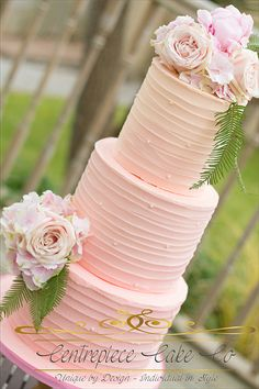 Buttercream rustic naked wedding cake fresh flowers ombre pink wedding cake by Centrepiece Cakes available across Plymouth Devon Cornwall Somerset London and UK