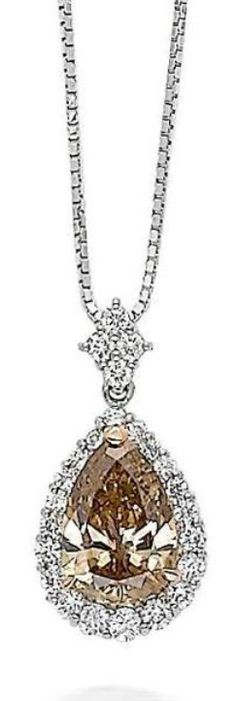 A diamond pendant necklace  Set centrally with a pear-cut diamond of brown hue within a round brilliant-cut diamond surround, to a round brilliant-cut diamond-set lozenge-shaped bale, all suspended from a box-link chain, mounted in platinum, the diamond of brown hue estimated to weigh approximately 3.50 carats, the remaining diamonds estimated to weigh approximately 0.70 carats in total, pendant length 2.6cm, necklace length 40.0 - 45.0cm
