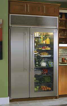 I absolutely love the idea of a glass door fridge. You can stock it full of colorful foods to bring some color to your kitchen and save some energy too since you wont have to open close open close etc. Glass Front Refrigerator, Glass Fridge, Side By Side Refrigerator, Refrigerator Freezer, See Through Refrigerator, 2 Door Fridge, Subzero Refrigerator, Refrigerator Organization, Decorating Kitchen