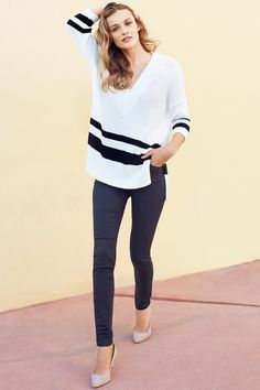 White V-neck sweater with 3/4-length sleeves, side slits, and wide black stripes. | Warm in H&M