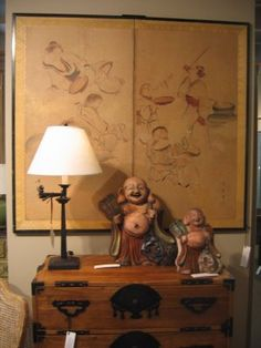 Japanese Antique Tansu with Byobu hangin g on the wall.
