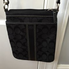 black coach cross body bag black coach crossbody bag! perfect condition like new. worn once but no sign of wear... has a front pocket and leather on the strap. has been sitting in my closet for some time..want it gone! Coach Bags Crossbody Bags