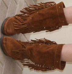 Vintage Minnetonka Brown Suede Fringe Midcalf Boots!  Awesome vintage Minnetonka boots!! These are in excellent condition and have very little wear on the soles. These boots are versatile and can be worn any season with any outfit! Pair with summer dresses and shorts or wear over skinny jeans in cooler weather. The same pair recently sold on Free People for 148!  No size but fits like 9 1/2  See at Mon Reve and Co on Etsy! $100.00