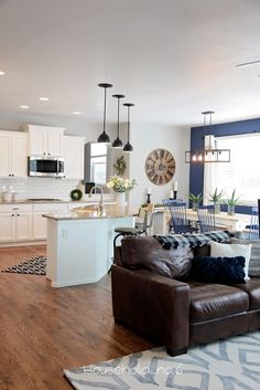 Household No.6 » Northern Colorado renovations and designs. Modern rustic dining room. Navy chairs with modern black lighting. White kitchen renovation