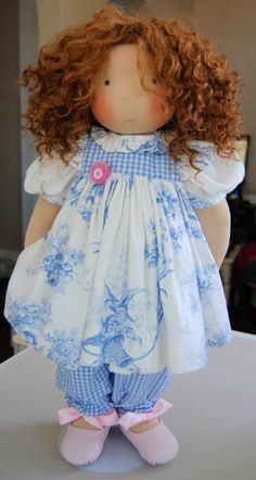 .Standing in her pretty clothes. Adorable doll.
