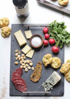 Served with buttery gougères, make this spring inspired cheese board complete with chives, ramps, and spicy radishes.