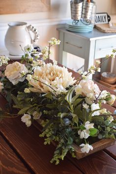 This giant farmhouse dough bowl boasts a variety of gorgeous faux florals including Peonies, Cherry Blossoms, Wax Flowers and Bay Leaves. Table Arrangements, Floral Arrangements, Flower Arrangement, Wax Flowers, Dough Bowl, Floral Centerpieces, Bowl Centerpieces, Centrepieces, Wedding Centerpieces