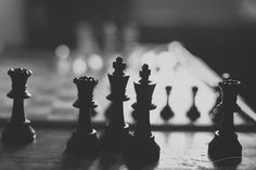 chess photograph, chess match, chess pieces, black and white photo, bokeh, chess still life