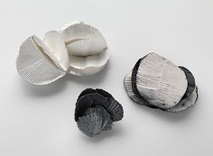 JULIE BLYFIELD-AUSTRALIA  Brooches: Shell Like, Folded Heart-Leaf, Spiral 2013  Oxidised sterling silver, enamel paint