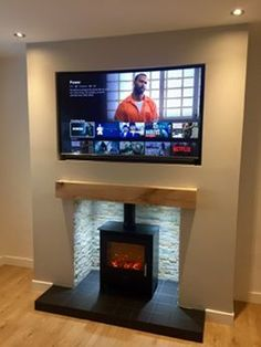 TV Above Oak Mantle Beam