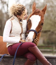 See below for info on my styled look and follow me on my Instagram @joslynj_equestrian for more equestrian style inspiration! . Happy Riding! . -Boots: Ariat® Challenge Contour Square Toe Field Boots in Cognac . -Breeches: Ariat Malbec Heritage Elite . -Vest: Horze Jadine Ladies Quilted Vest. . -Jacket: Orvis Women's Classic Barn Jacket. . -Gloves: Roeckle Grip Gloves in Camel. . -Belt: Tory Leather Trim Stitched Belt in Buck Brown.
