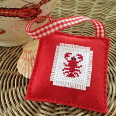 Cross-stitch, crochet, and hand-sewing patterns and inspiration from a needlework designer. Mini Cross Stitch, Cross Stitch Embroidery, Cross Stitch Designs, Cross Stitch Patterns, Cross Stitches, Lobster Party, Crab Art, Nautical Christmas, Cross Stitch Christmas Ornaments